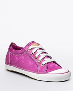 I have to get these!!....Pink Coach Sneakers