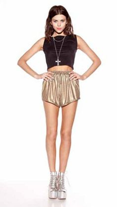 Blades Of Glory Short $50.00 Bold gold foiled jersey high waisted shorts. Curved hemline with a drawstring and elastic waist. By MINKPINK.