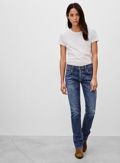 White tee and slightly baggy skinny jeans
