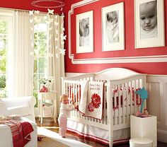 Stronger Than Pink - Baby Girl Nursery  Love the color and the contrast of the white molding and large portraits. (no, I'm not having a baby...)