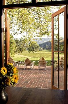 from Country Living Made Beautiful I would love to be sitting here looking out. Love the brick patio! I always dream of a big backyard Country Living, Country Style, Country Patio, Outdoor Spaces, Outdoor Living, Beautiful Homes, Beautiful Places, Vie Simple, Window View