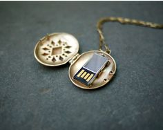 USB Locket by Emily Rothschild. Super cute gift if the usb then had pictures of the friends together, letters, etc :) Jewelry Box, Jewelry Accessories, Jewellery, Do It Yourself Inspiration, Spy Gadgets, Thanks For The Memories, Locket Necklace, Necklaces, Geek Chic