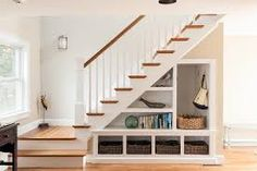 17 Under Stairs Storage Ideas For Small Spaces One of my favorite features of their home is a grand staircase right past the front door that has some awkward storage space underneath.Hasil gambar untuk Under Stair Storage Ideas Staircase Storage, Staircase Design, Under Stair Storage, Stair Design, Open Staircase, Under Staircase Ideas, Entryway Storage, Cottage Staircase, Small Space Staircase