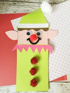 festive Christmas Elf brown paper bag craft for kids - great for toddlers & preschool children too! SO CUTE & great celebration for elf on the shelf families!