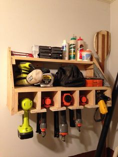 Double shelves for screws, sanders, glue, etc. with slots for hanging nail guns and drills