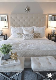 Kelley Nan: Master Bedroom Update- Calming White and neutral master bedroom with tufted ottoman stools, Pottery Barn Tall Lorraine Headboard, Diamond linen quilt and hadley ruched duvet