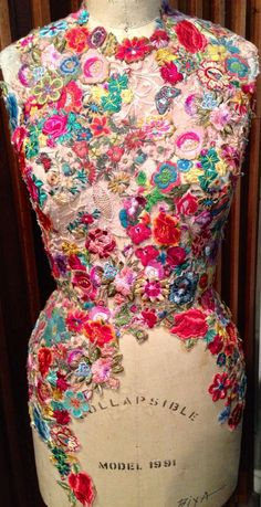 repinned: coquita / tailor's dummy decorated/encased in floral jewelled shell.