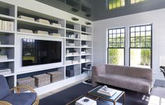 Custom collection of art books in neutrals for Hamptons client