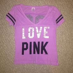 Purple VS PINK shirt Purple VS PINK v-neck shirt with black and silver detailing. PINK Victoria's Secret Tops