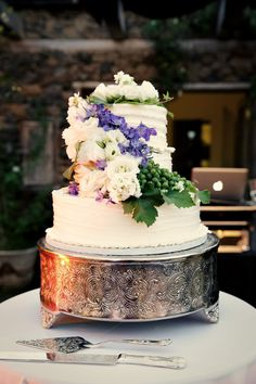 Pretty purple and green floral wedding cake {Photo by Josh Goodman via Project Wedding}