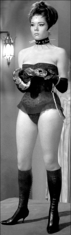 """Diana Rigg as Ms. Emma Peel (""""Miss S-M Appeal"""") in the classic Avengers episode """"A Touch of Brimstone"""". Note the numerous phallic items."""