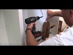 Use wood clamps to hold them together, and attach them with two screws in each cabinet wall.