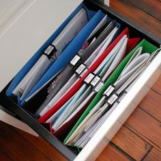 Use binder clips instead of having hanging files in your cabinet inside of file folders :: OrganizingMadeFun.com