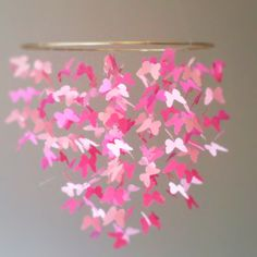 Over 300 pastel-pink shapes float lazily above your little one in this magical floating butterfly mobile ($44), custom-made by Etsy seller Bottz Studios.