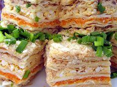 Виявляється, «Наполеон» буває не лише з кремом і горіхами. Узявши за основу листкове тісто, можна приготувати і смачну закуску. Безперечно, страва ця – для святкового столу.