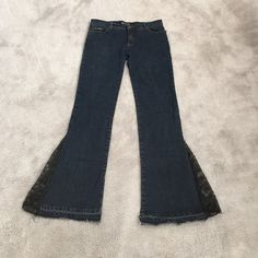 Jeans with lace sides. These are dark jeans with black lace sides. The lace starts about mid shin. Jeans Flare & Wide Leg
