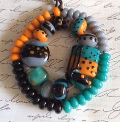 Lampwork Glass Bead Set in Pumpkin Black Gray and by marshalljodie
