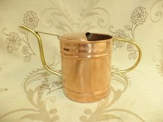 This listing is for a small French copper watering can suitable for indoor plants. This was purchased at a French market and is made from copper with a brass handle and spout. diameter of base 10cm height 12cm #copperwateringcan #frenchcopper #copperhome #copperhomedecor #copper