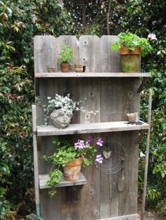 An old fence, with an addition of shelves and a base becomes a structural piece for the right garden spot. I can do this!