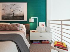 "Remember to take into account the proportion of both your space and your bed when choosing bedside storage pieces. For a wide room with a low platform bed, for example, you might be best served by a low, wide nightstand that can hold more than just the bare necessities. ""This wider nightstand can easily accommodate a large digital music player,"" notes designer Diego A. Rincon."