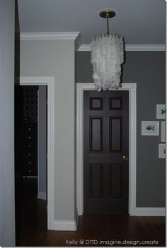 black doors, white trim, and double grey wall in the hall way..I love this