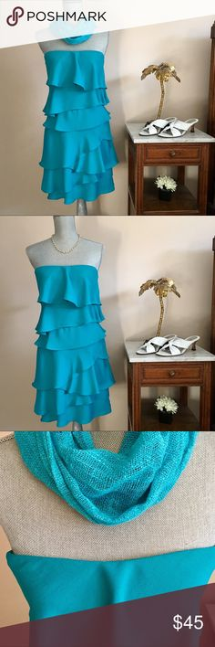Layered BCBG Strapless Dress Fun and flirty aqua BCBG strapless dress. Springtime is calling! This dress has tiered layers, optional adjustable straps, and striking coloring. Great for all occasions 😀 BCBGMaxAzria Dresses