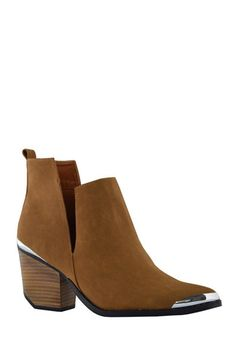 A modern silhouette meets classic styling to create this edgy, versatile bootie. Silver tone details at the toe and heel accent a chic, independent vibe. Pull on styling; all man made materials. Shoe fits true to size.  New Colors Added.