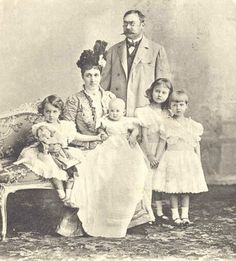 Grand Duke Guillaume IV of Luxembourg and his wife, Grand Duchess Maria-Anna (nee Princess of Portugal), with 4 of the 6 princesses:  left to right, Princess Hilda, baby Princess Antonia, Princess Marie-Adelheid, and Princess Charlotte.