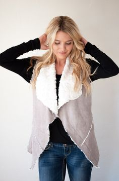 These Shearling vests are so soft you won't want to take them off! Each vest features a suede fabric on the outside and a faux fur lining. Oh, and did we mention it has pockets!