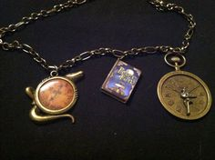 "Peter Pan book necklace  On 16"" brass chain Croc clock and fairy clock charms  $16"