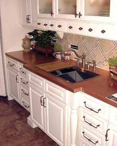 Black Cabinets With Butcher Block Counter Tops And