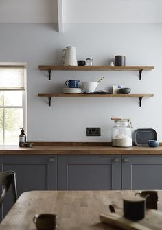 Our beautiful slate grey Fairford range offers the perfect look for your shaker style kitchen. Match it with natural wood worktop shelving and table to complete the look. Be inspired by Howdens.