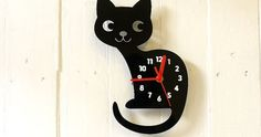 Above is a cat shaped clock , It is laser cut from acrylic and comes from Boo Boo And Ted .