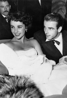 Elizabeth Taylor and Montgomery Clift attend the premiere of 'The Heiress,' 1949.