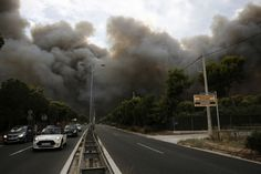 """Over 70 Dead, Hurt/Missing As Greek Wildfires """"Struck Like A Flamethrower"""" - Russia News Now Russia News, It Hurts, Fire, Train, World, Pictures, Bbc News, Ankara, Wordpress"""