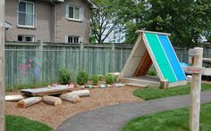 Lakeshore Nursery School playground design by Earthscapes.  Love the recycled doors!