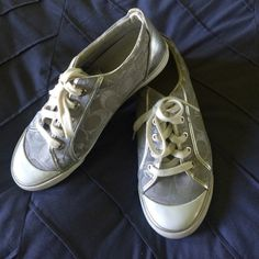 Coach Silver Sneakers Good condition ! Some scuff marks and visible signs of wearing. Shoes Sneakers
