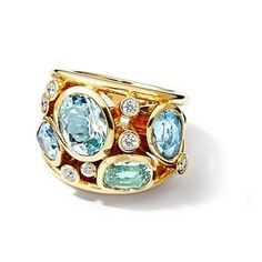 51f7556f9bf7ad Aeneus ring in 18k yellow gold set with four blue aquamarines (1 oval, 2  pears and 1 cushion shape, total 5.22cts) and diamonds (@0.20ct)