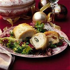 Stuff thin chicken breasts with sauteed spinach and onion, four cheeses, and a blend of spices, then wrap in phyllo dough for an elegant and delicious chicken entree that's perfect for entertaining.  Serve on a bed of mixed greens.