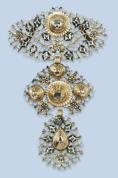 AN ANTIQUE DIAMOND PENDANT   Composed of three graduated panels, finely pierced and set with rose-cut diamonds, Flemish, circa 1800