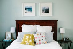 love the dark wooden headboard with the crisp white sheets and pop of color with accent pillows #theeverygirl