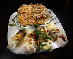 Round 1, Challenge 4: Denise Allen serves a spring roll stuffed with veggies and mint with her shrimp stir-fry with carrots and cellophane noodles.