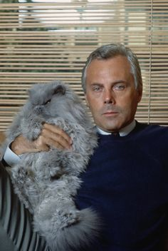Pin for Later: 80 Reasons Birthday Boy Giorgio Armani Is the World's Most Stylish Man Giorgio Armani Giorgio Armani at home with his cat in Milan, 1982.