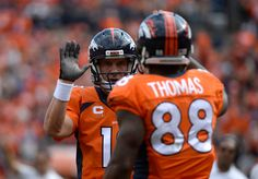 Peyton Manning (18) of the Denver Broncos congratulates Demaryius Thomas (88) of the Denver Broncos after a touchdown in the second quarter. The Denver Broncos played the Kansas City Chiefs at Sports Authority Field at Mile High in Denver, Colorado on September 14, 2014. (Photo by John Leyba/The Denver Post)-- #ProFootballDenverBroncos