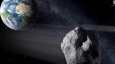Large asteroid safely zips past Earth, dragging its moon along