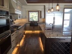 Kitchen Perimeter:  Raised panel doors painted Benjamin Moore Barely Beige with Coffee Glaze Antique Brown granite counter  Island:  Oak raised panel doors stained Cappucino  Elkay Antique Hammered Copper sinks  Contemporary Brushed Oil-Rubbed Bronze handles  LED accent lighting.  #kitchen #Design #Cabinet #Cabinetry #Custom #Quality #LED #Lightening #Inspiration