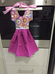 These oven dress handtowels are a unique and pretty gift for a loved one. They also help to cover up your oven. Towel Dress, Dish Towels, Kitchen Towels, Sewing Projects, Oven, Cover Up, Gym, Summer Dresses, Trending Outfits