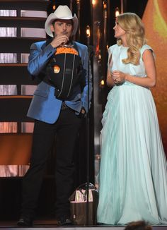 Hosts Brad Paisley and Carrie Underwood perform during the 48th annual CMA Awards at the Bridgestone Arena on November 5, 2014 in Nashville, Tennessee.