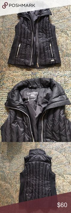 Calvin Klien black vest Medium, black Calvin Klein best.  -Premium down  -multiple zip pockets  -headphone access  -no spots or stains  -only worn once, I'm an extra small so it's a little big. Calvin Klein Jackets & Coats Vests