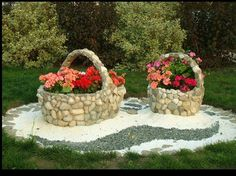 Use stone compositions with flowers or plants in the shape of baskets, vases, or urns to create interest in your garden.